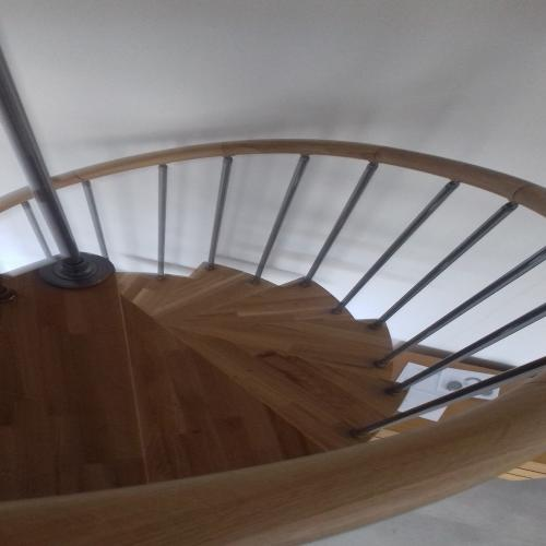 Chrome and medium walnut Spiral  Staircase.